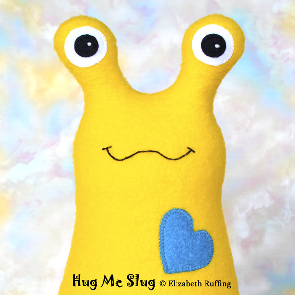 Plush Stuffed Animal Hug Me Slug by Elizabeth Ruffing, in bright yellow and turquoise