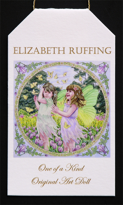 Fairies and Butterflies watercolor painting by Elizabeth Ruffing on a hang tag