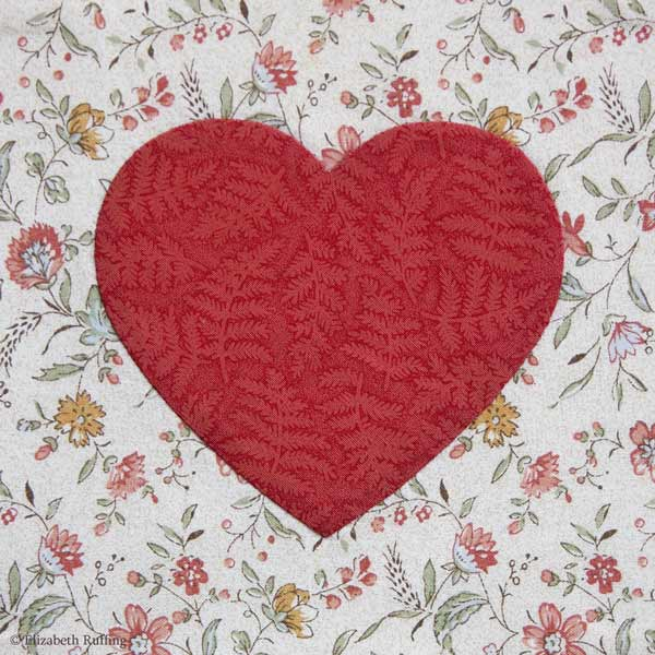 Needle-turn applique red heart on floral fabric, Elizabeth Ruffing