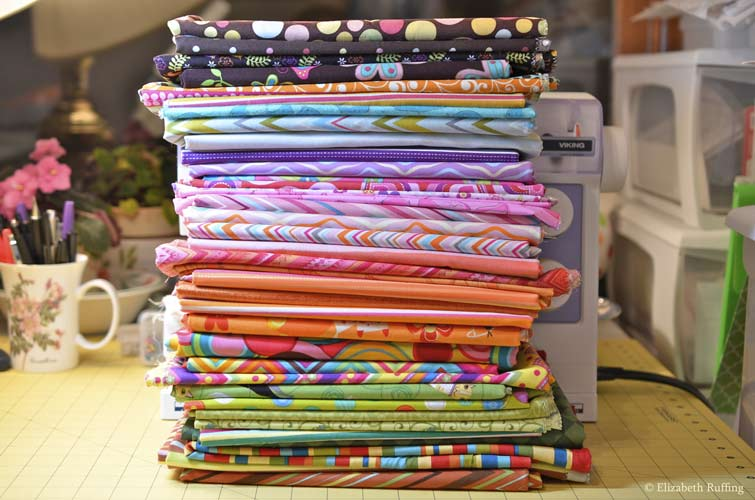 Stack of quilting cotton prints, Elizabeth Ruffing