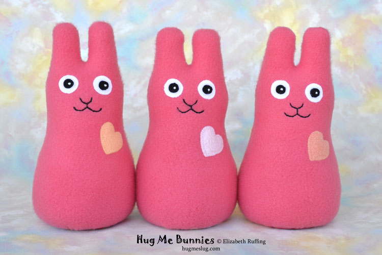 Coral pink Hug Me Bunnies handmade stuffed animal rabbit art toys by artist Elizabeth Ruffing
