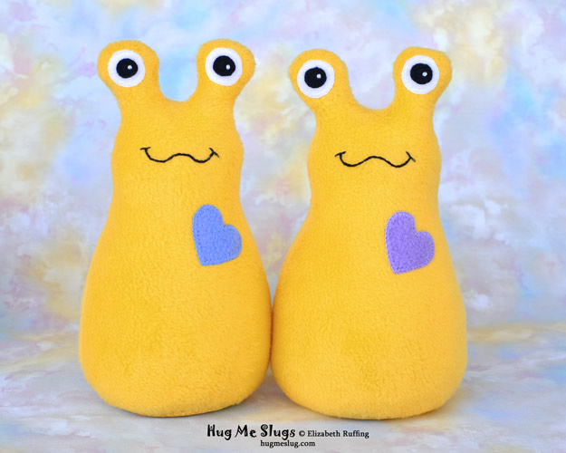 Daffodil yellow Hug Me Slugs handmade stuffed animal banana slug art toys by artist Elizabeth Ruffing