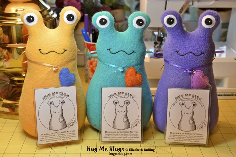 Fleece Hug Me Slug handmade stuffed animal art toys by artist Elizabeth Ruffing with personalized hang tags