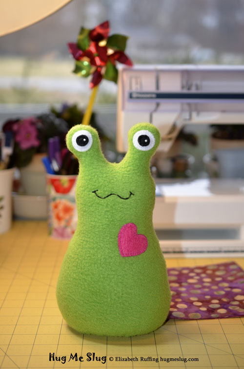 Grass green Hug Me Slug stuffed animal art toy by artist Elizabeth Ruffing