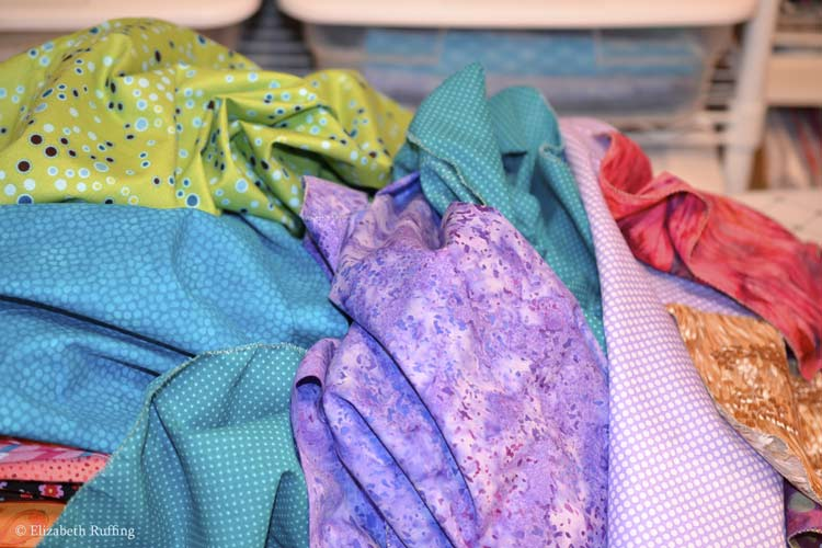 Multicolored quilting fabrics in a pile waiting to be washed, Elizabeth Ruffing