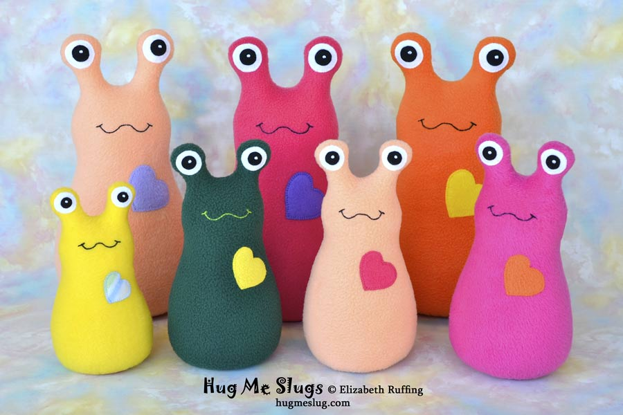Assorted Hug Me Slugs stuffed animal plush art toys by Elizabeth Ruffing