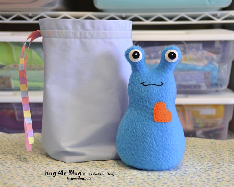 Bright blue 7 inch Hug Me Slug, plush stuffed animal toys by Elizabeth Ruffing