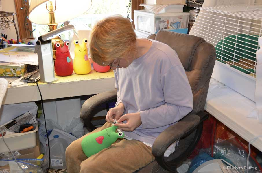 Elizabeth Ruffing sewing Hug Me Slug eyes