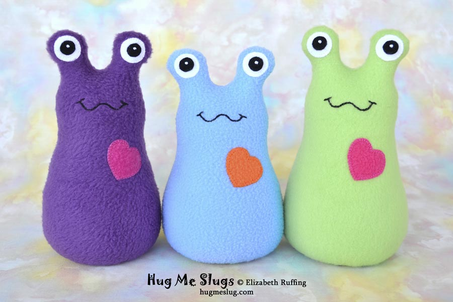 Fleece Hug Me Slugs,plush stuffed animal art toys by Elizabeth Ruffing, purple, light blue, pear green