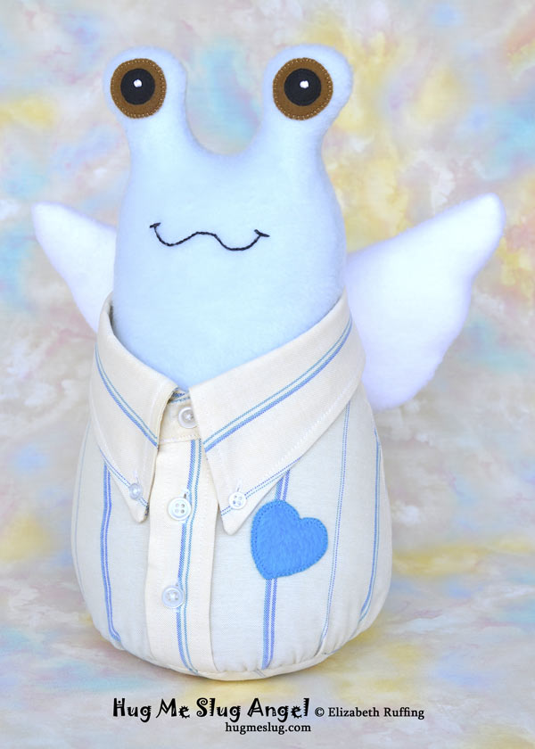 Stuffed toy Hug Me Slug Angel, wearing a button-down shirt by Elizabeth Ruffing, side view