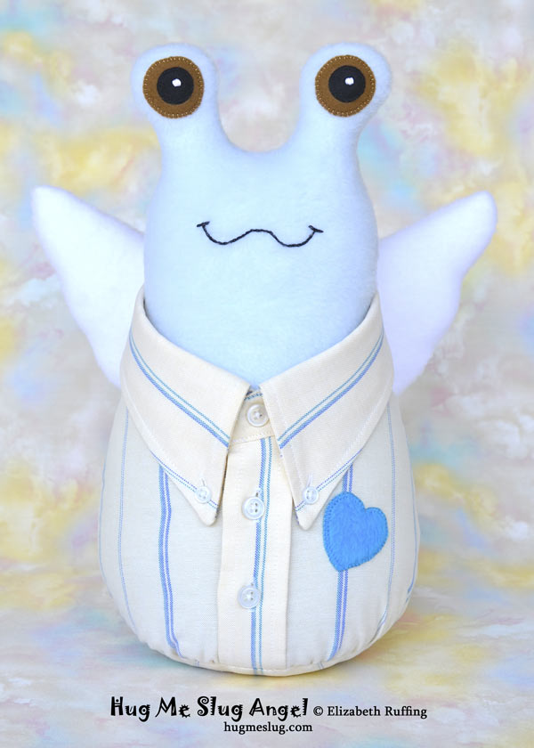 Stuffed toy Hug Me Slug Angel, wearing a button-down shirt by Elizabeth Ruffing