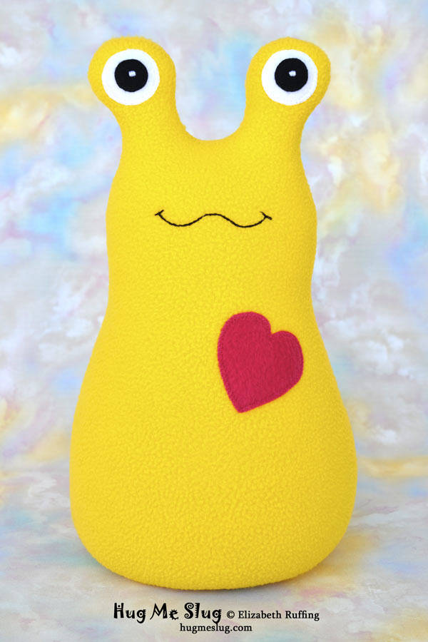 Handmade Lemon Yellow Hug Me Slug Stuffed Banana Slug Plush Toy Animal, Red Heart, 12 inch, by artist Elizabeth Ruffing's