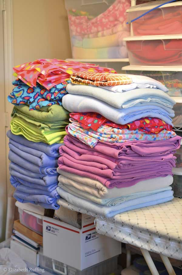 Piles of fleece all pre-washed and folded and by Elizabeth Ruffing