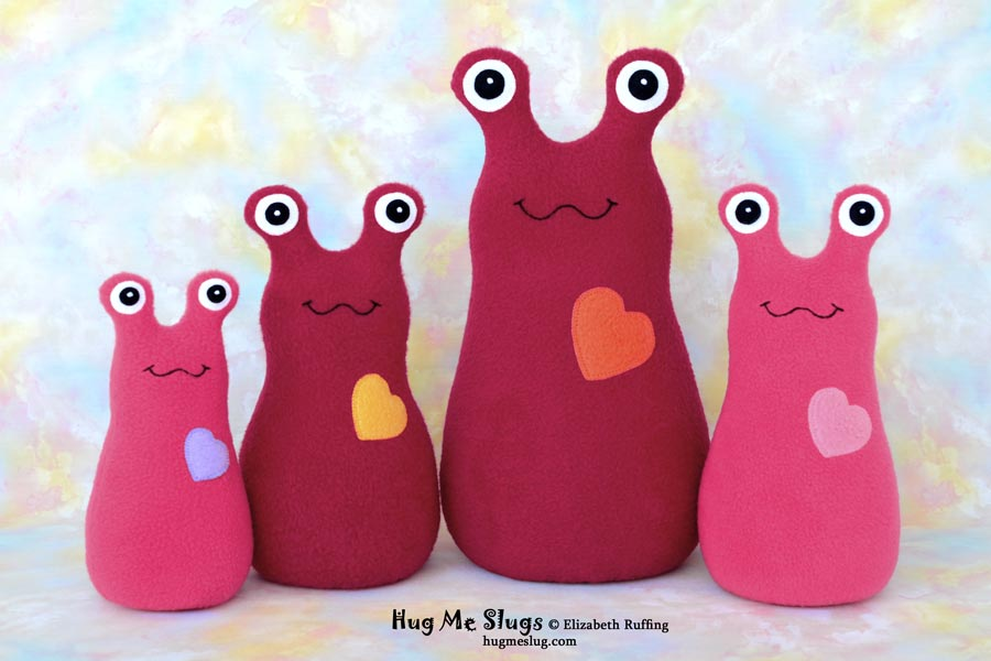 Red and watermelon fleece Hug Me Slug stuffed animal art toys by Elizabeth Ruffing