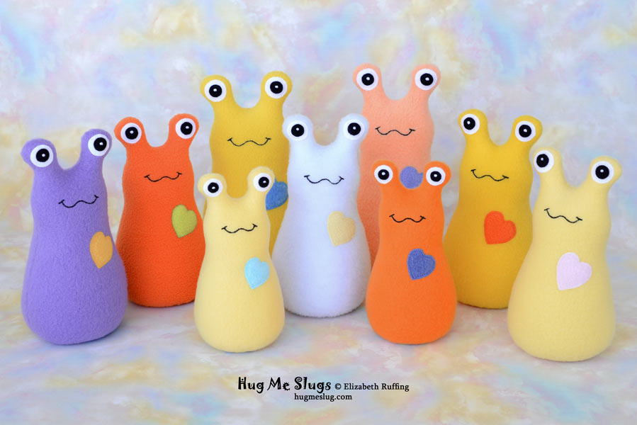 Orange, yellow, purple fleece Hug Me Slug stuffed animal art toys by Elizabeth Ruffing