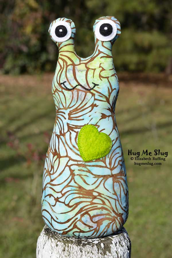 Green, turquoise batik Hug Me Slug stuffed animal art toy by Elizabeth Ruffing