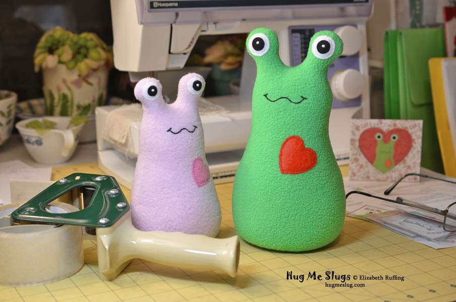 Pink and green Hug Me Slugs stuffed animal art toys by Elizabeth Ruffing