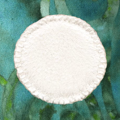 Spoonflower Faux Suede white circle with Wonder-Under fused to background and sewn
