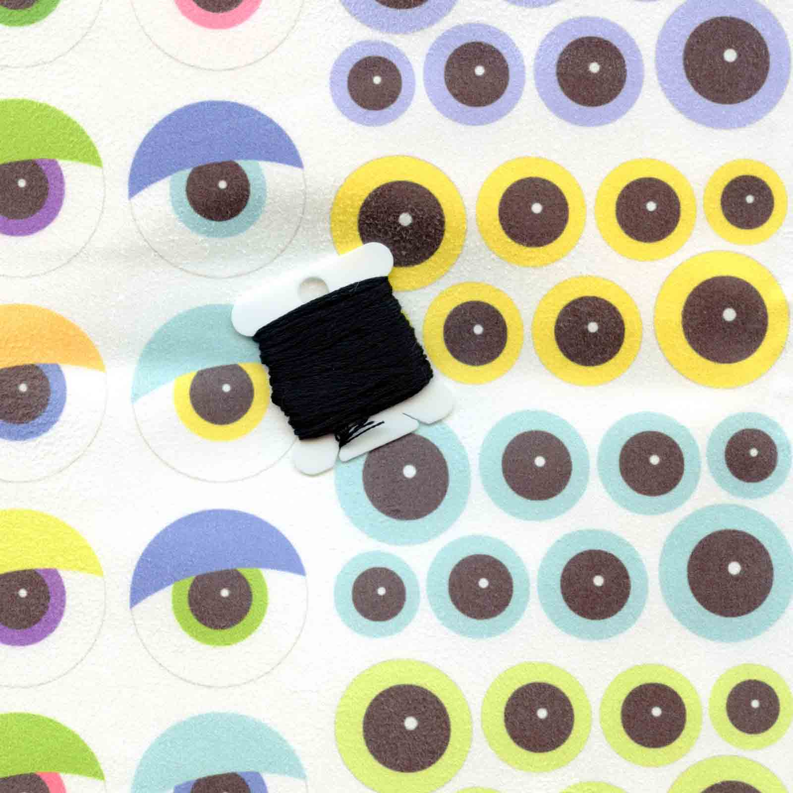 Spoonflower Faux Suede colored eyeballs compared to black
