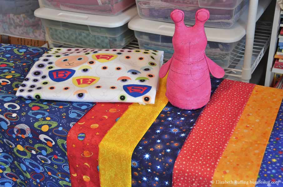 Super Slug stuffed animal superhero in progress by Elizabeth Ruffing and cape fabrics