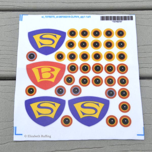 Spoonflower fleece sample, eyeballs and emblems by Elizabeth Ruffing