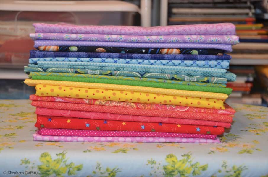 Pile of cotton print fabrics, Elizabeth Ruffing