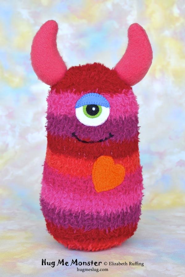 Hug Me Monster, sock doll art toy, red, orange pink striped, by Elizabeth Ruffing