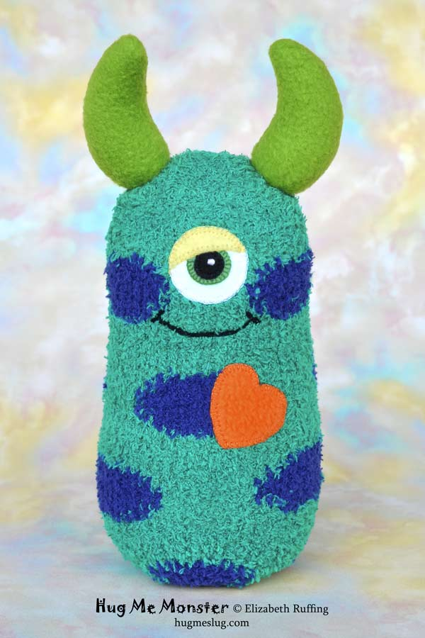 Hug Me Monster, sock doll art toy, green and blue-purple polka dotted, by Elizabeth Ruffing