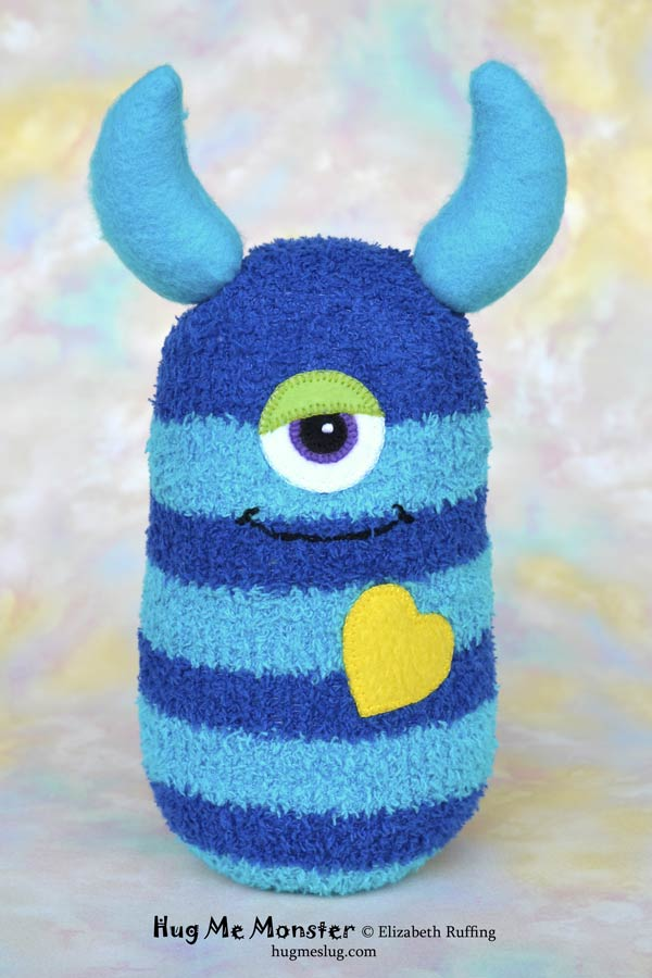 Hug Me Monster, sock doll art toy, royal blue and turquoise striped by Elizabeth Ruffing