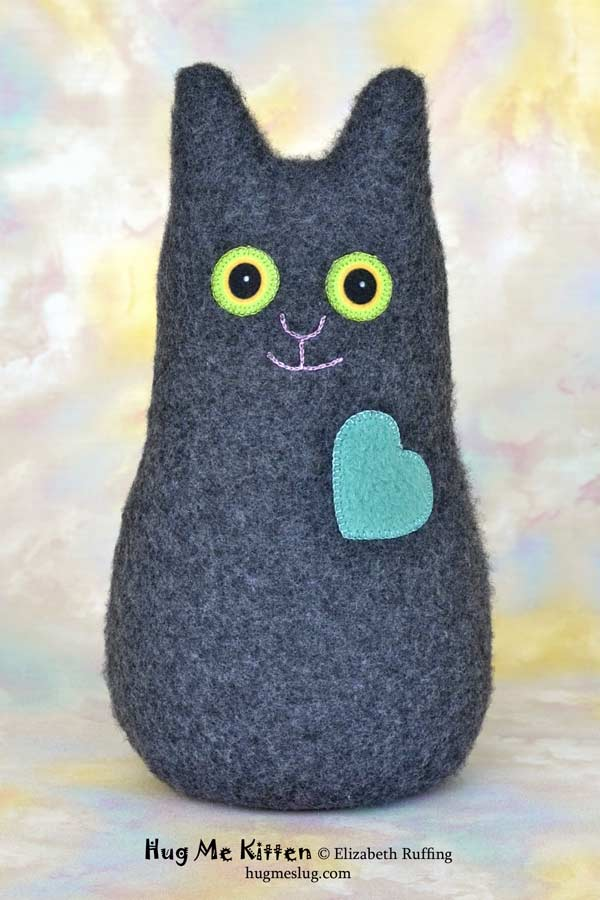 Hug Me Kitten plush art toy, charcoal gray with a teal heart, by Elizabeth Ruffing