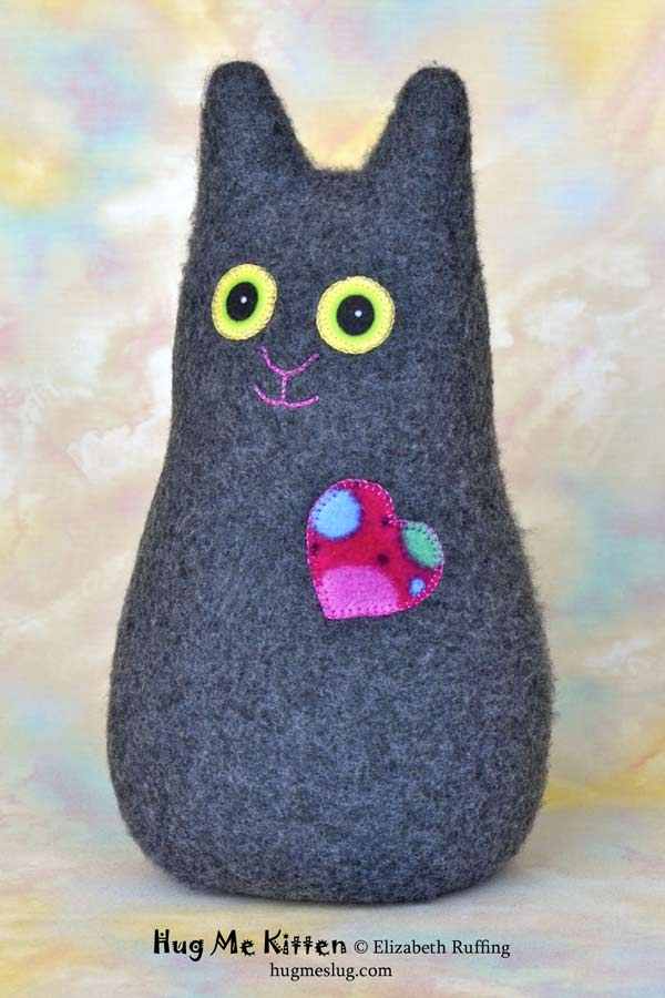 Hug Me Kitten plush art toy, charcoal gray with a rose-red polka dot heart, by Elizabeth Ruffing