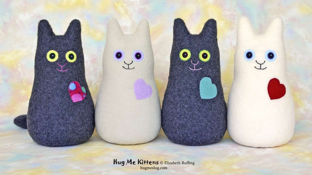 Hug Me Kitten plush art toy, charcoal, oatmeal, and cream, by Elizabeth Ruffing