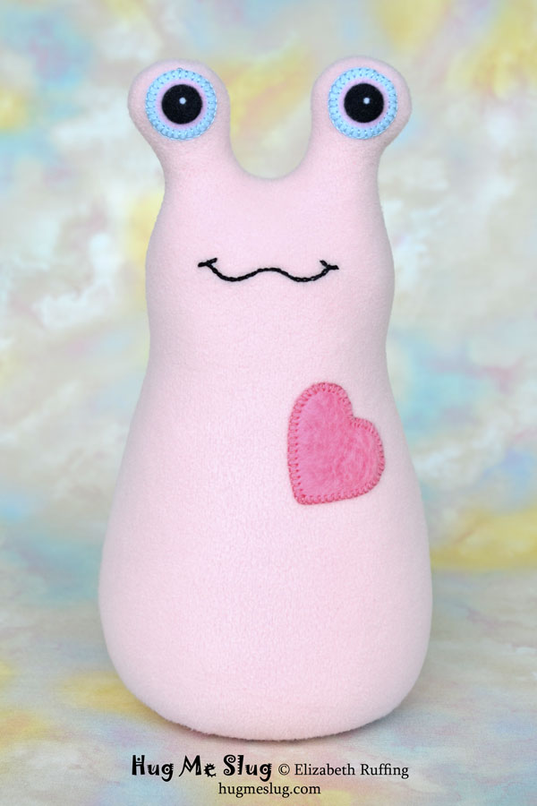 Hug Me Slug plush art toy, pink fleece plushie, by Elizabeth Ruffing