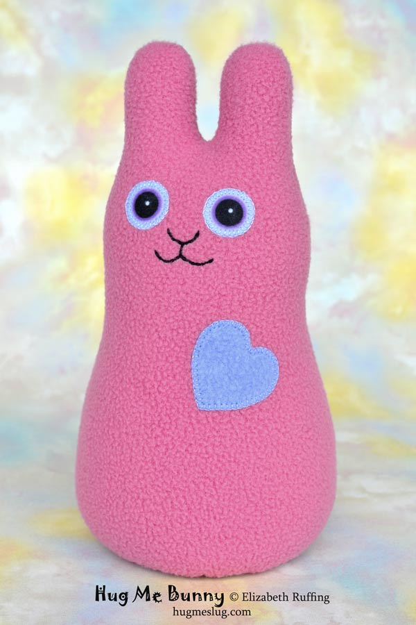 Hug Me Bunny plush art toy, mauve-pink fleece plushie, by Elizabeth Ruffing