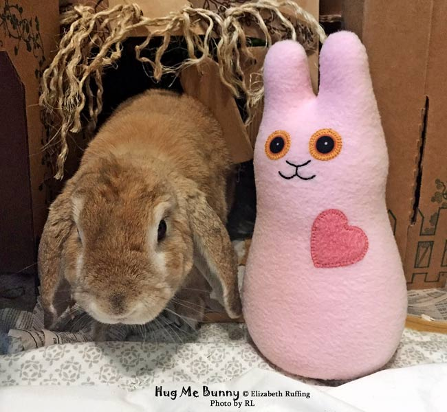 Pink fleece Hug Me Bunny, handmade plush stuffed animal rabbit, by Elizabeth Ruffing, with tan rabbit