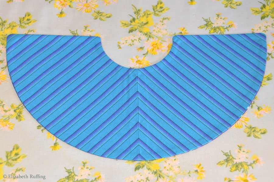 Bias-cut, chevron striped lining of Super Slug's cape, by Elizabeth Ruffing