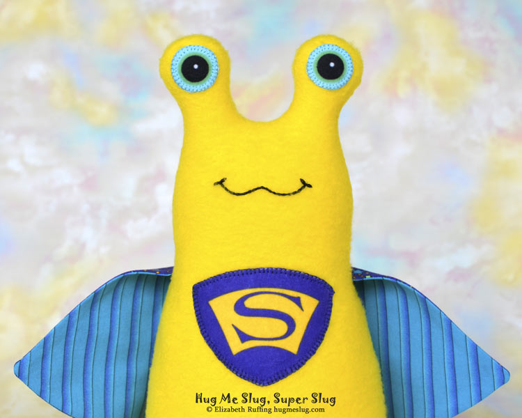 Super Slug plush art toy, yellow and purple-blue, by Elizabeth Ruffing