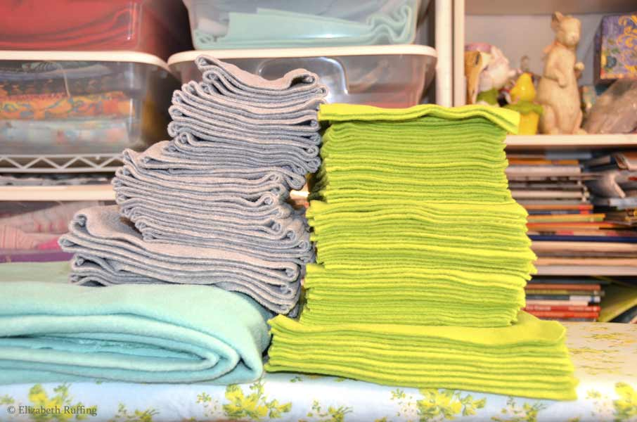 Stacks of fleece and toy bodies in progress, by Elizabeth Ruffing