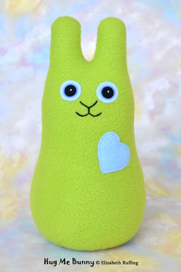 Apple green Hug Me Bunny plush toy by Elizabeth Ruffing
