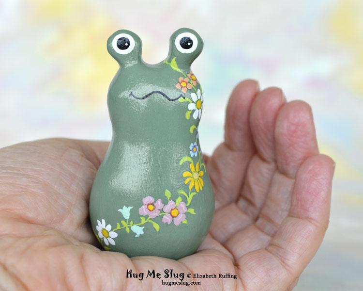 Hug Me Slug figurines by Elizabeth Ruffing