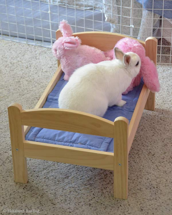 Oliver Bunny helping plays under his IKEA doll bed, by Elizabeth Ruffing