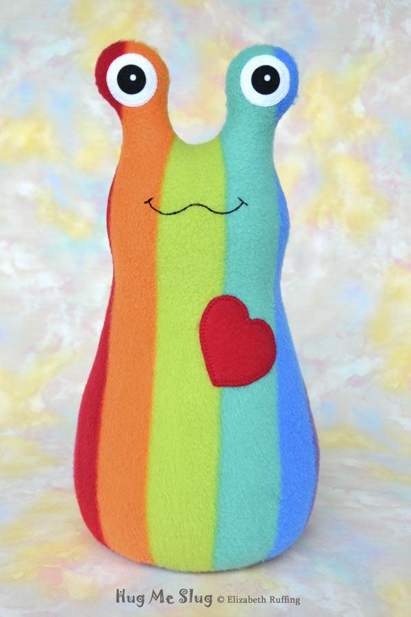 Rainbow striped Hug Me Slug, handmade stuffed animal plush toy by Elizabeth Ruffing, 12 inch