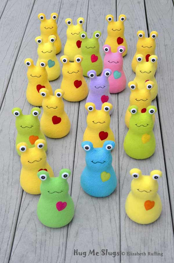 Assorted Marching Handmade Fleece Hug Me Slug Stuffed Animal Plush Art Toys by artist Elizabeth Ruffing