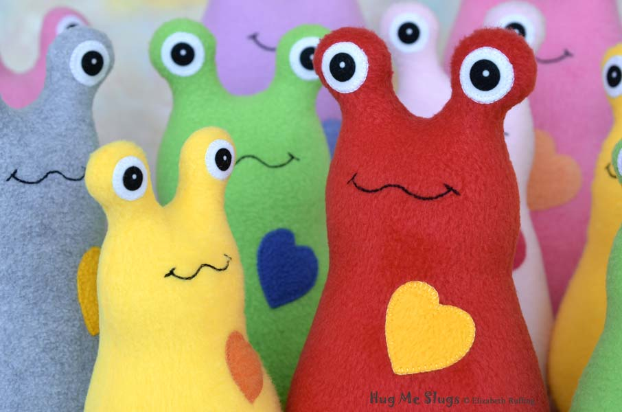 Hug Me Slug handmade plush stuffed toy animals by Elizabeth Ruffing, assorted colors
