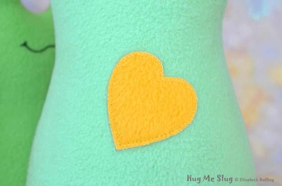 Blanket Stitched Heart on Handmade Fleece Hug Me Slug Stuffed Animal Plush Art Toy by artist Elizabeth Ruffing