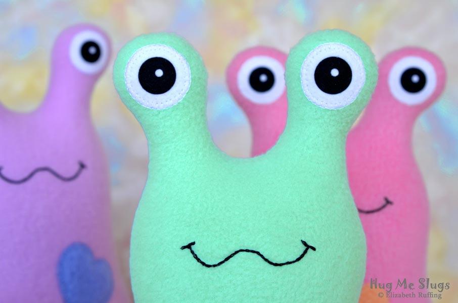 Assorted 12 inch Handmade Fleece Hug Me Slug Stuffed Animal Plush Art Toy, Apple Green Heart by artist Elizabeth Ruffing