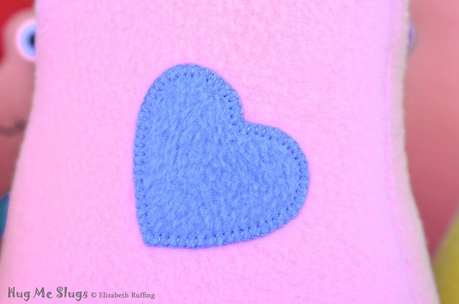 Blanket Stitched Heart on Handmade Fleece Hug Me Slug Stuffed Animal Plush Art Toy by artist Elizabeth Ruffing