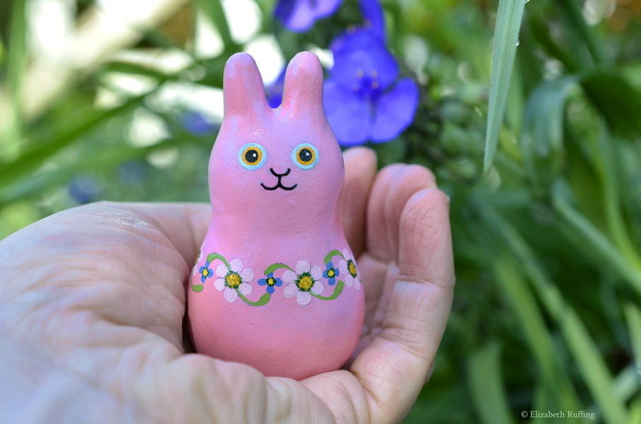 Maisie Maybunny, original, one-of-a-kind miniature handmade mauve-pink floral bunny rabbit art doll figurine by artist Elizabeth Ruffing with blue purple spiderwort flowers