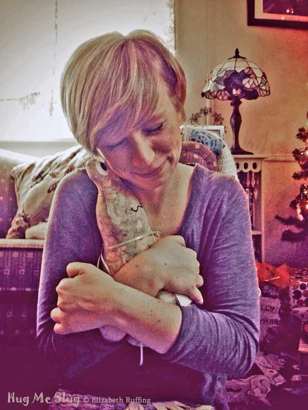 12 inch Handmade Batik Hug Me Slug Stuffed Animal Art Toy, by artist Elizabeth Ruffing, getting a hug