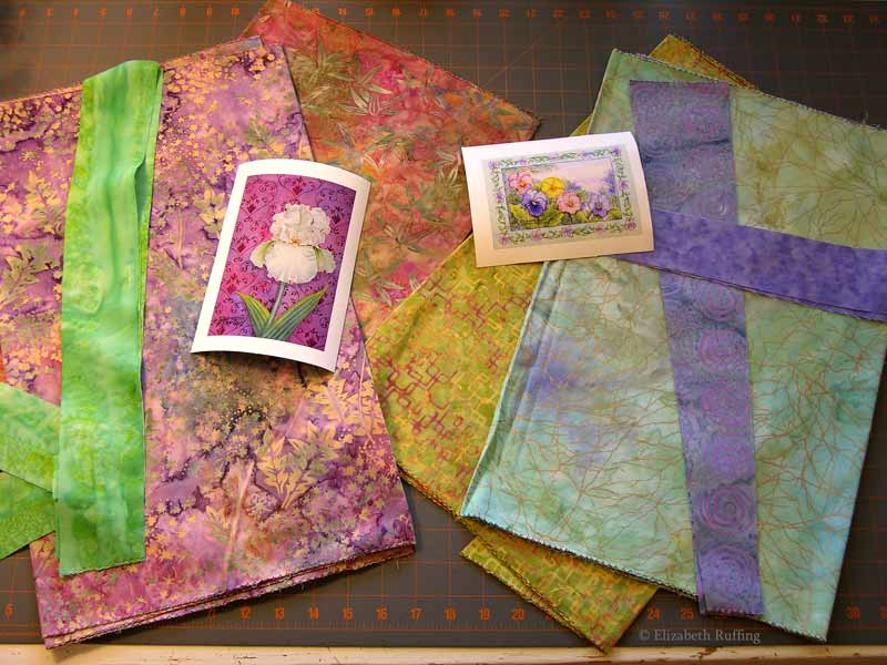 Iris and Pansy art quilts in progress, with batik fabrics, by Elizabeth Ruffing